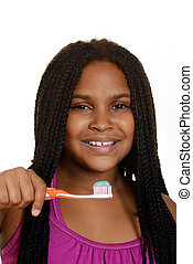 girl child with toothbrush