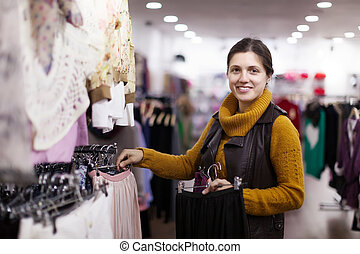Girl choosing   at clothing store