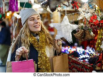 Girl choosing Christmas toys