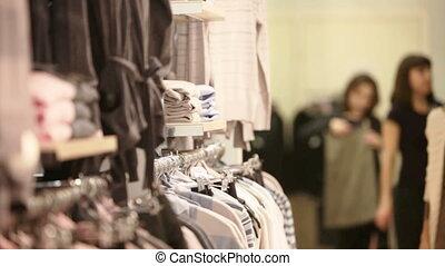 Girl choosing pullover - Attractive blond girl choosing a ...