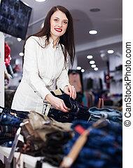 Girl choosing trousers