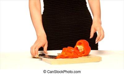 Girl chopping red pepper