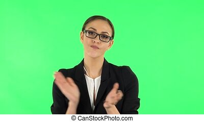 Girl claps her hands with dissatisfaction. Green screen