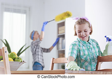 Girl cleaning at home