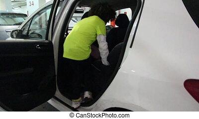 girl climb on a car