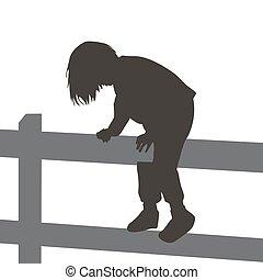 Girl climbing a wooden fence