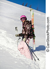 Girl climbing for a freeride - Girl with skis climbing for a...