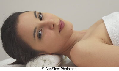Girl closes her eyes on the massage table