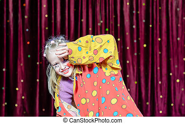 Girl Clown Shielding Eyes from Bright Stage Lights
