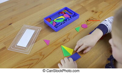 Girl collects geometric shapes - Little girl collects...