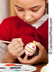 girl colored Easter eggs