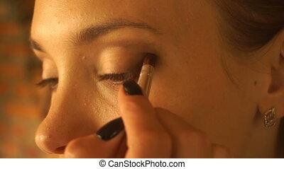 girl colors eye shadow and brush