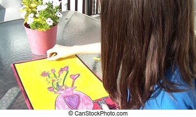 Girl Colors Her Drawing Outside - Girl colors original...