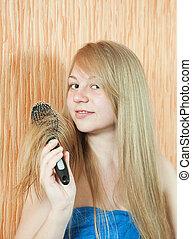 Girl combing her long hair