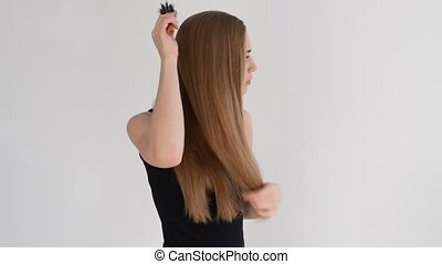 girl combing of her hair