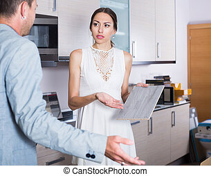Girl communicating with assistant of kitchen about bad service