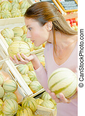 girl comparing melons