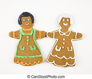 Girl cookies holding hands.
