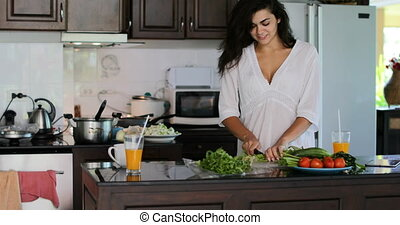 Girl Cooking Meal In Modern Kitchen Cutting Vegetables Frying, Young Woman Happy Smiling