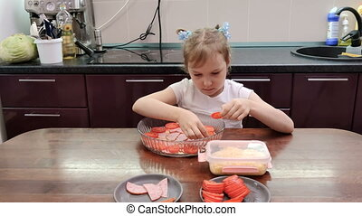 girl cooking pizza in kitchen
