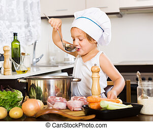 girl cooking soup  with ladle