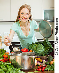 girl cooking with vegetables in domestic kitchen - girl...