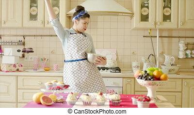 Girl cooks goofing around