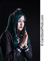 girl cosplay anime character pray in dark