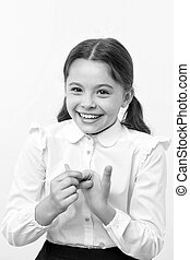 Girl counting on fingers. First of all. Girl school uniform smiling face yellow background. Girl happy back to school. Child ready back to school end continue fun. Schoolgirl formal outfit looks cute