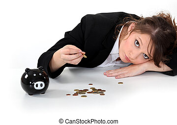Girl counting the money of her piggy bank