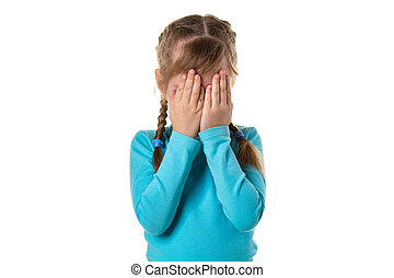 Girl covering her eyes by hands, isolated on the white background