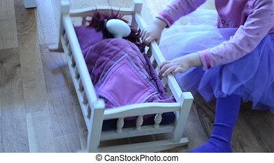 girl cradled doll
