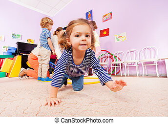 Girl crawl on active class lesson in kindergarten - Portrait...