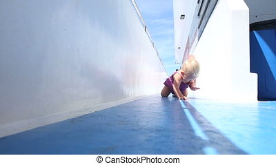 girl crawling on deck