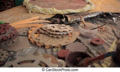 Girl creating decorative item - Woman stapling fabric to...