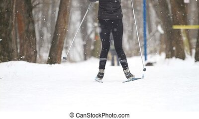 Girl cross country skiing in the winter park
