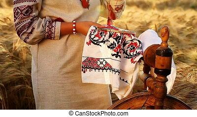 Girl cross stitching national ethnic ornament - nice video...