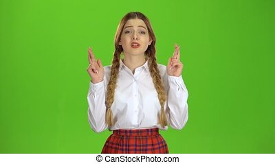 Girl crossed her fingers. Green screen - Girl crossed her...