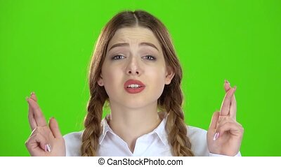 Girl crossed her fingers. Green screen - Girl crossed her...