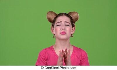 Girl crossed her fingers. Green screen