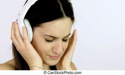 Girl crying listening music closeup