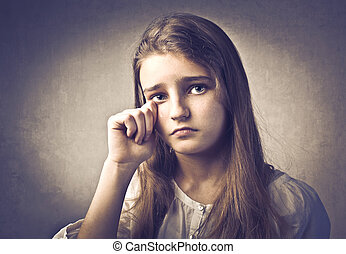 girl crying on dark background