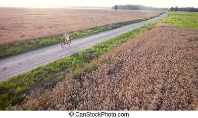 girl cycling. Aerial view