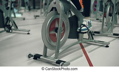 Girl Cycling - Tilt up the unrecognizable girl doing cardio...
