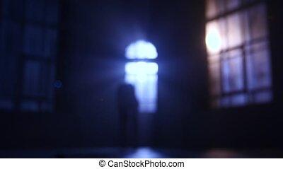Girl dancer dancing in moonlight from the window. Defocused...