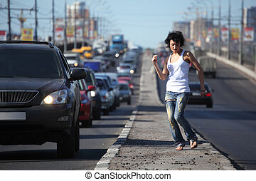 girl dances on highway middle