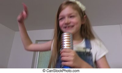 Girl dancing and singing