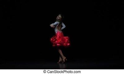Girl dancing ballroom-sports dance, dark background. Slow motion