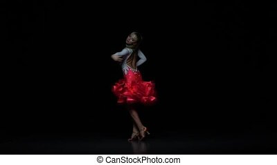 Girl dancing ballroom-sports dance, dark background. Slow...