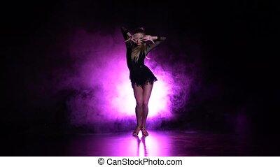 Girl dancing elements of sport - ballroom dance in the studio. Slow motion